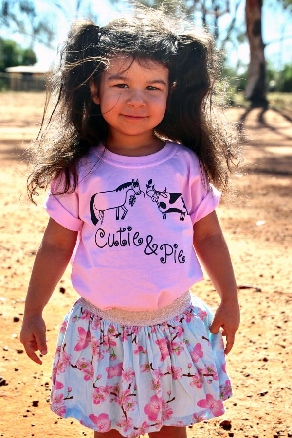 girl in pink cutie pie shirt