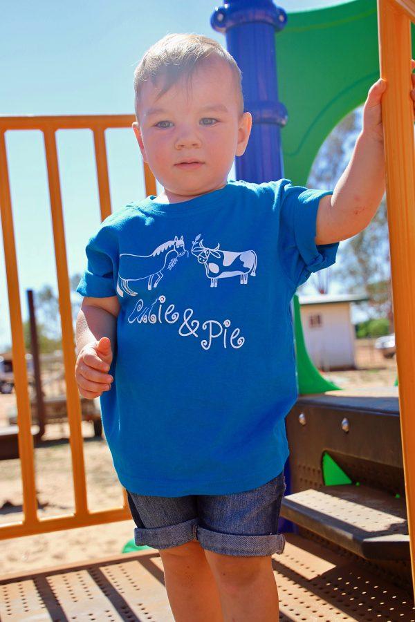 boy in blue cutie pie shirt