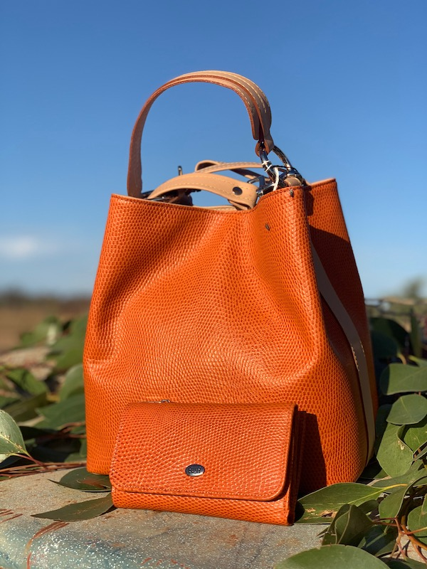 Orange Lizard Print Bucket Bag with matching purse.